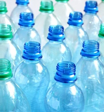 Many empty water bottles. Shallow DOF.