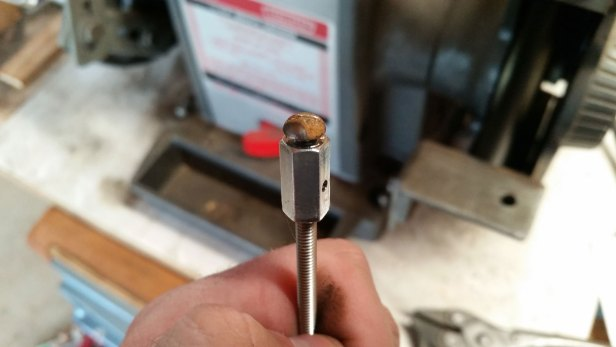 I used a #8-32 coupler nut and some threaded rod to make a holder for the machine screws in order to wire wheel their heads.