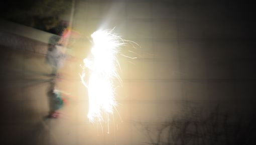 People with sparklers blurry