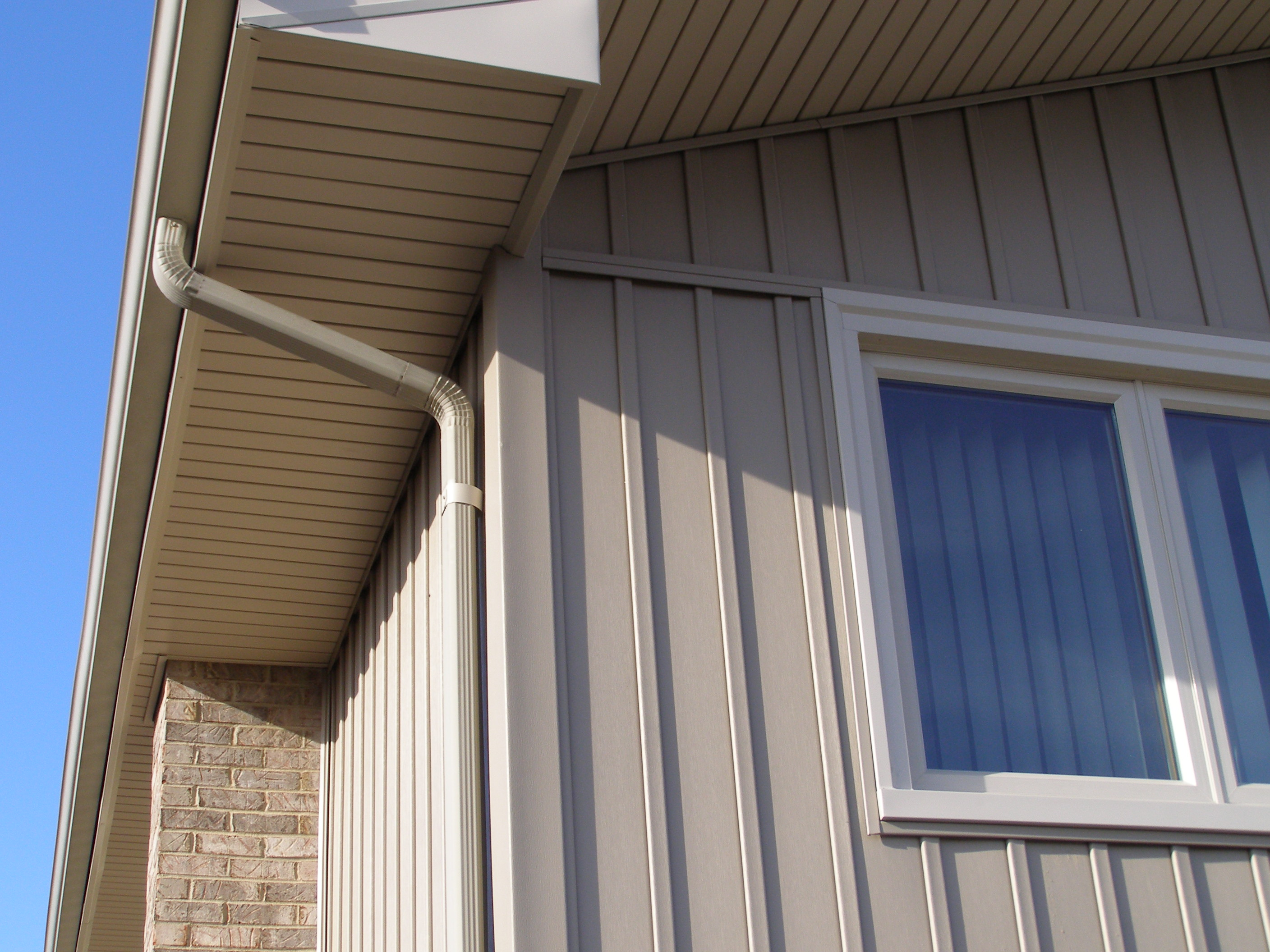 Board batten vertical siding siding windows roofing for Vertical siding options