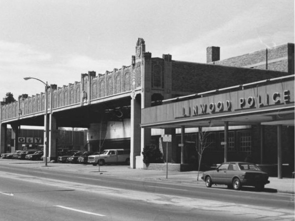 The Firestone Building at the corner of Linwood and Troost in 1984, when the Linwood Police Station was next door.