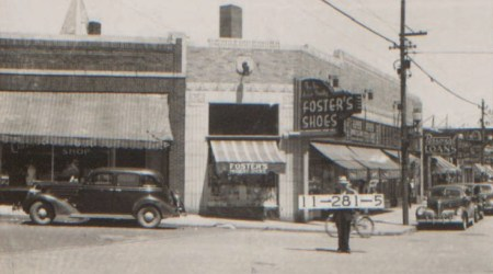 While this block around Westport Road and Main Street has changed since 1940, the building at this corner remains. Today it is home to Oddly Correct; in 1940, it was the location of a Foster's Shoe Store.
