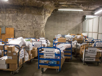 At the Giving the Basics warehouse, items are sorted and packaged for local pantries.