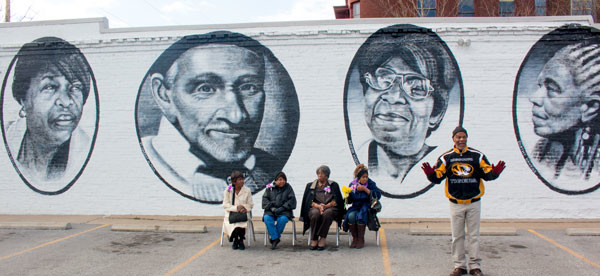 """The grandmothers of Mannheim"" posing in front of their mural at 39th and Troost."