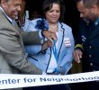 UMKC Chancellor Leo Morton, State Senator Kiki Curls and Police Chief Darryl Forte cut the ribbon for the new Center for Neighborhoods at 4747 Troost on Saturday.