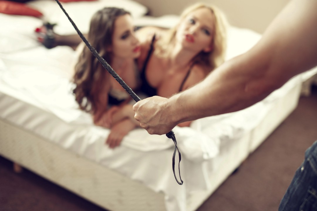Sexy macho holding whip with lesbian lovers, threesome and bdsm