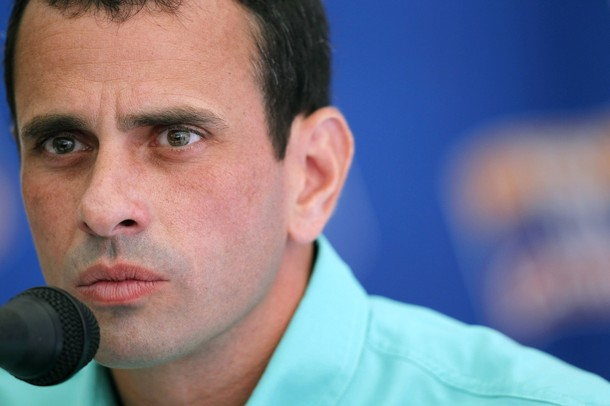 Opposition frontrunner presidential candidate Henrique Capriles Radonski speaks to the foreign media in Caracas