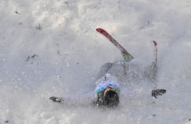 Zhibek Arapbayeva of Kazakhstan falls during the women's freestyle aerials qualifications at the Vancouver 2010 Olympics in Vancouver, British Columbia, Saturday, Feb. 20, 2010. (AP Photo/Mark J. Terrill)