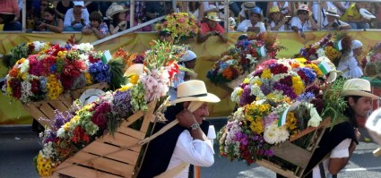 Our trip started in Medellin for the Flower Festival. This parade marks the end of the festival and signifies when farmers used to carry the flowers from the small villages into Medellin on their back.