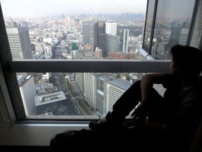 Shawn Reece enjoying the view from our 50th floor suite at the Park Hyatt Tokyo.