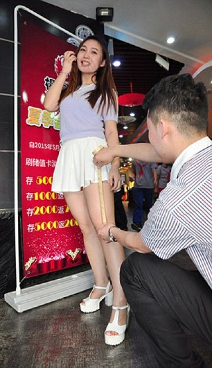 "Pic shows: Female customer wearing short skirts. The restaurant offers them discounts if their hems are over 33 cm above the knees. Women restaurant-goers are been given massive discounts - if they wear short skirts. Female punters at a hotpot eatery in the city of Jinan, in east China's Shangdon Province, have been told they will get a whopping 90 percent discount on grub if their miniskirt hems are over 33cm above the knee. While those whose skirts are over 8cm above the knee get 20 percent off. To decide on what discount they get, a doorman checks their skirt lengths with a tape measure. Now the restaurant says it has been flooded with mini-skirted women eager for some cheap nosh. A spokesman said: ""We wanted to do a promotion on our hotpot and we came up with this. ""Girls like showing off their legs and now they can get more than just admiring glances from passersby - they can get cheap food too."" The move has received mixed reactions from locals. One writing on social media, De-Ho2 said: ""I don't see the problem. ""Clubs also let women wearing short skirts into the front of the queue. It's an unwritten rule."" Another, Shen Liang, posted: ""Best idea ever."" But others have been less keen on the idea, slamming it as sexist. One, AnTsai, complained: ""I have long, beautiful legs but I will be damned if I am going to let some strange man measure my skirt length for a crappy hotpot #outraged."" Another, Xin Kao said: ""You'll probably find hidden cameras under the tables too. Disgusting and cheap."" (ends)"