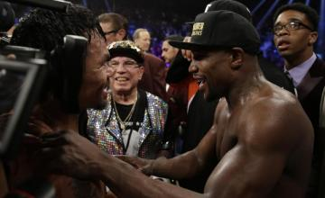 Manny Pacquiao, from the Philippines, left, is greeted by Floyd Mayweather Jr. after their welterweight title fight on Saturday, May 2, 2015 in Las Vegas.  (AP Photo/Isaac Brekken)