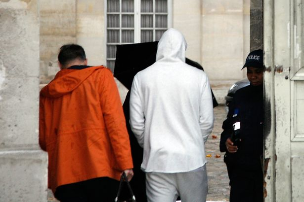Karim-Benzema-C-wearing-a-white-hooded-jersey-arrives-at-the-police-station-in-Versailles