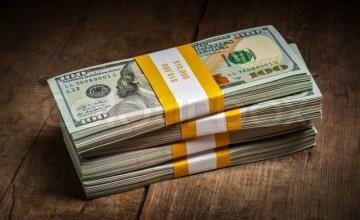 11578172-stacks-of-100-dollars-banknotes-bundles