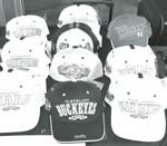 Negro League hats on display at tribute game.