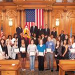 Thirty high school seniors who received scholarships at a luncheon are photographed in the Common Council Chambers with Mayor Tom Barrett, Common Council President Willie L. Hines, Jr. and other Milwaukee-area dignitaries.