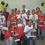 Winners of the 2011 Housing Authority Spelling Bee with (from left, back row): HACM Commissioner Sherri Daniels; radio personality Earl Ingram; HACM Education Specialist Darrell Finch; HACM Senior Asset Manager Beverly Johnson; and Milwaukee Urban League President & CEO Ralph Hollmon.