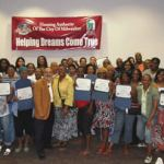 Housing Authority Executive Director and Martha Love with Make Your Money Talk graduates.