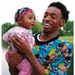 Derek Williams holds his daughter Ta'Nijah Williams,