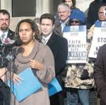 Jennifer Epps-Addison, Economic Justice director for Citizen Action of Wisconsin, speaks at the press conference held on Monday morning in front of the Milwaukee Courthouse announcing the complaint being filed against Rite-Hite CEO. (Photo by Robert A. Bell)