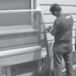 SDC's Tim Sobczak prepares a storm window for installation during Rebuilding Together Greater Milwaukee Day