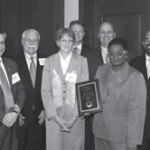 Congresswoman Gwen Moore presents the Edson Award to (left to right) Murphy Antoine, Torti Gallas; Paul Casey, Ballard Spahr; Bobbi Marsells, Housing Authority of the City of Milwaukee; Robert Courtney, PNC Real Estate; Todd Crow, PNC Real Estate; and Common Council President and Housing Authority Board Chairman Willie Hines, Jr.
