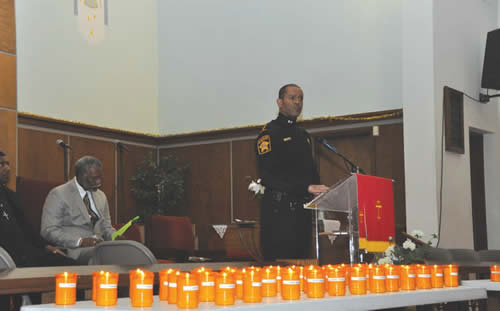 Sheriff-Clarke-spoke-New-Years-Eve-Candlelight-Vigil-2013-homicide-victims-near-candles-lit-each-victim