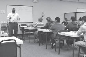 Instructor Terrence Moore explains the ACT test to high school students taking part in the free ACT Wings Workshop at SDC.