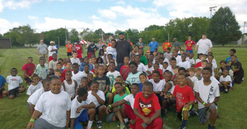 Gilbert Brown and camp participants sharing a moment all together