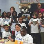 Milwaukee Bucks mascot Bango distributed books to summer school students at Pierce Elementary School on July 1st, 2015.