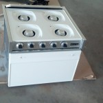 The stove being reassembled, it looks gret, I can't believe how much better it looks