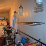 """The smaller shelf going up, I just used some 3"""" lag bolts straight into the steel"""