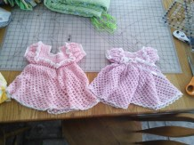 The dress on the left is the dress that my grandma crocheted for me when I was born, the one on the right is the exact same pattern but 30 years newer for MiniM :). Her's has an added bow and flower of course! Pretty stinking cute!