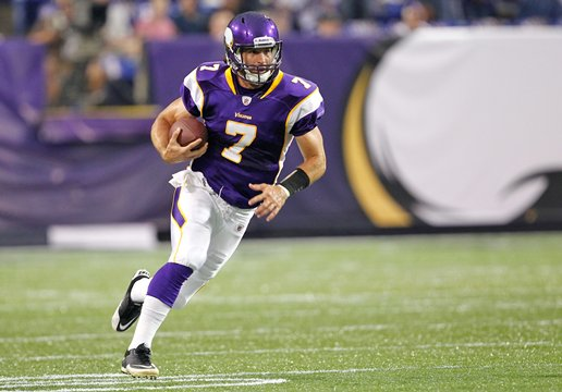 Photograph of Christian Ponder running against the Houston Texans