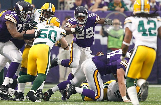 Photo of Adrian Peterson Breaking Off A Run Against The Green Bay Packers
