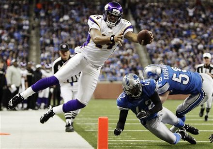Photo of Joe Webb diving for yards against the Detroit Lions