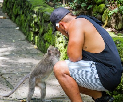 Tourist and Monkey at Sacred Monkey Forest Ubud Indonesia