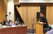 Student Pedro Alforque, 19, talks to trustees Thursday, Oct. 22.