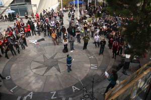 students listen in on a rally against budget cuts on Wednesday