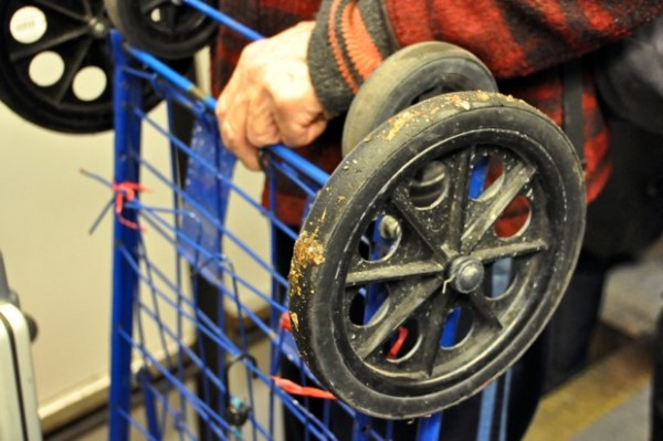 """I'm going to take the wheels off of this cart that I found, and put on better ones."""