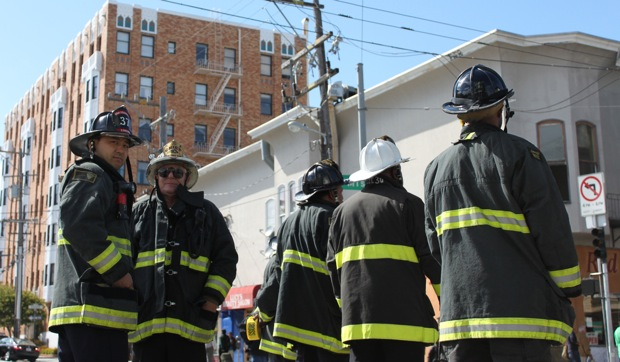 Firefighters survey the downed wires. Photo by Christine Mai-Duc.
