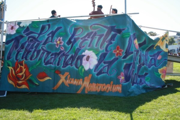 The banner behind the main stage reads: The United People Celebrating Life.