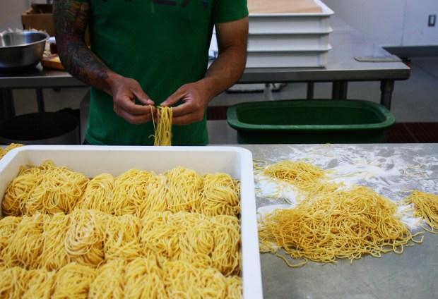 Richie Nakano of Hapa Ramen sorts noodles at La Cocina. Photo by Heather Smith.