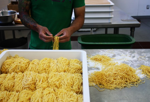 Richie Nakano of Hapa Ramen sorts noodles at La Cocina. Photo by Heather Smith.