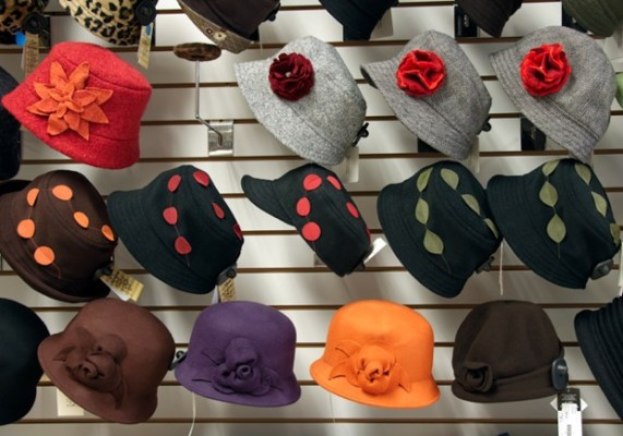 ADS store mosaic of cloche hats with hand-made flowers and shorty caps with ultra suede appliques by Tachkova, and bell cloches by Toucan.