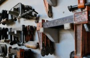 The walls are filled with tools, patterns, and clamps that help Pacific Frame's woodworkers create the intricate custom designs their business is known for.
