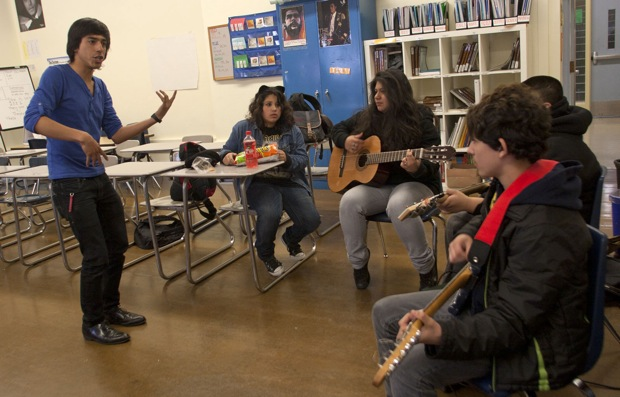 How to place your hands on the guitar. Amaranta Canizal, 13, is the singer for the group.