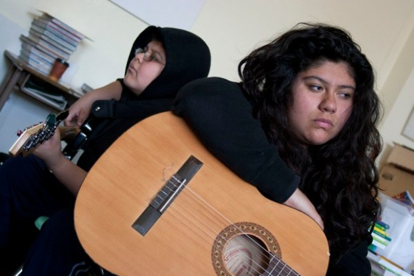 Pedro Cavich, 12, (with hood) accompanies Juliana Sierra, 13.