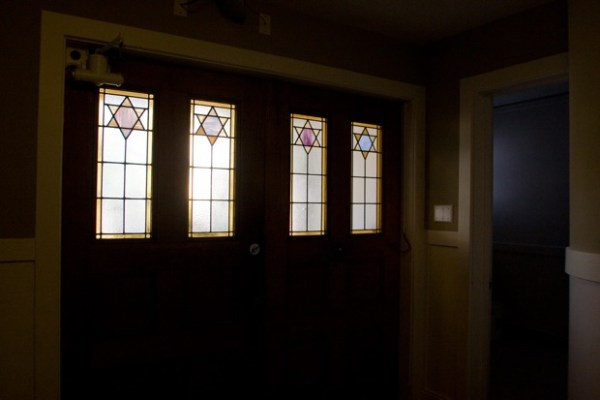 From the inside, the original stained glass windows of the front door of the synagogue.