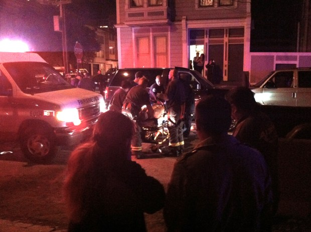 EMTs attending to the victim at 7:30 p.m. Photo sent in by a reader.